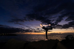 Sunset yoga session in Canarias Stock Photo