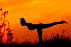 Sunset yoga Stock Photography
