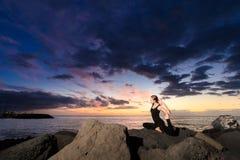 Sunset yoga on Tenerife beach Royalty Free Stock Photo