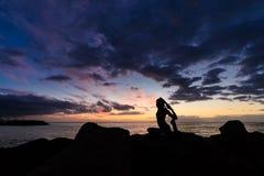 Sunset yoga on Tenerife beach Royalty Free Stock Images