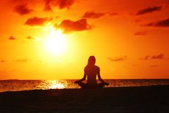 Sunset yoga woman Royalty Free Stock Image