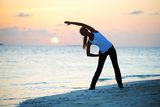 Sunset yoga woman Royalty Free Stock Images