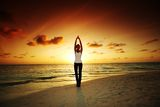 Sunset yoga woman Stock Photography