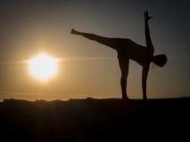 Sunset yoga Stock Image