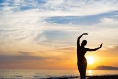 Sunset yoga woman meditation on Ocean coast. Sunset yoga woman meditation on Ocean coast Stock Photography