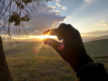 Sunset in your hand Royalty Free Stock Photo