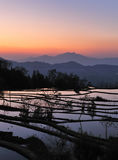 Sunset of YuanYang Rice Terrace. Yuanyang County is a county of YunNan province, China. It is home to the most spectacular terraced rice fields in the world. The Royalty Free Stock Photos