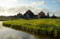 Sunset in zaanse schans. With pond foreground and windmill at the background Stock Photography