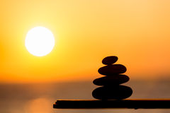 Sunset and zen stones Royalty Free Stock Photos