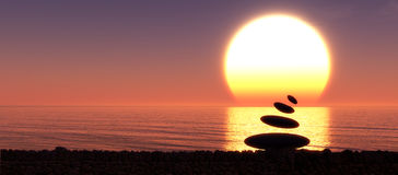 Sunset and Zen stones Stock Photo