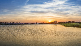 Sunset in Zinnowitz with   backwater Stock Photo