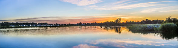 Sunset in Zinnowitz with reflection of the backwater Royalty Free Stock Photography