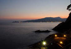 Sunset from Zoagli. Long Exposition photo at Sunset from marina of Zoagli to Portofino Royalty Free Stock Image