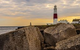 Sunseting over portland bill lighthouse stock images