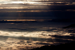 Sunsets & Sunrises, overzees van wolken Royalty-vrije Stock Afbeeldingen