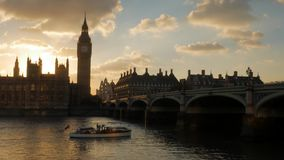 Sunsets behind Parliament as boat passes stock video