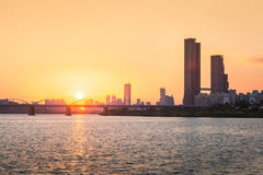 Sunsets behind the skyscrapers of yeouido and bridges across the. Han River in Downtown Seoul, South Korea Stock Images