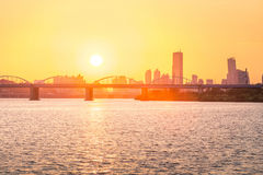 Sunsets behind the skyscrapers of yeouido and bridges. Across the Han River in South Korea Stock Photo