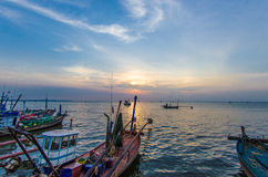 Sunsets and fishing boats. Stock Photos