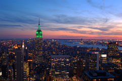 Sunsets on Manhattan. The sun goes down, the lights come on at dusk in New York City Royalty Free Stock Photography