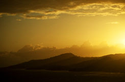 Sunset over the Mountains. The sunsets over the mountains in the tropics Stock Image