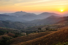 Sunsets over mountains and valley Royalty Free Stock Photo