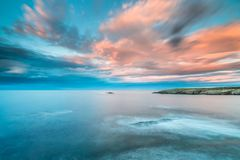 The sunsets in the sea of the coasts and beaches of Galicia and Asturias. Have nothing to envy to other parts of the world, where the spectacular colors of the stock photo