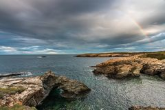 The sunsets in the sea of the coasts and beaches of Galicia and Asturias. Have nothing to envy to other parts of the world, where the spectacular colors of the royalty free stock images