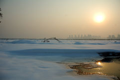 Sunsets on snowfield Royalty Free Stock Image