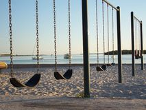 Sunsets, Swings and Sailboats Royalty Free Stock Images