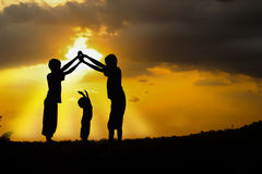 Sunsets. Three brothers, boys play at sunset royalty free stock photos