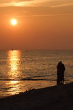 Sunsetting on beach. Romantic walk with beach , sunsetting Stock Photography
