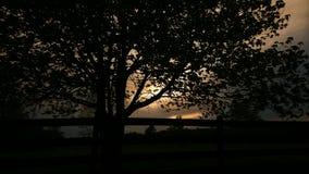 Sunsetting inom molnen Arkivfoto