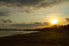 Sunsetting at the Mertanadi beach. The picture was taken in Sanur, Bali Stock Photography