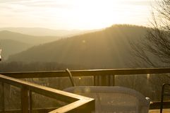 The sunsetting over the mountains. Easily viewed from the seating area on the deck in the Appalachian Mountains of North Carolina Stock Photo
