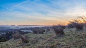 Sunsetting på de Pentland kullarna Arkivbild