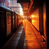 Sunsetting on train platform. Golden sunset on platform at Leeds City Station Royalty Free Stock Photography