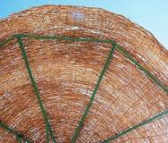 Sunshade. Against blue sky by the sea Stock Photos