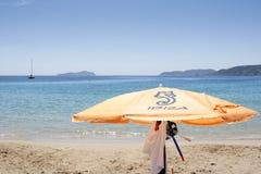 Sunshade. Orange sunshade in the beach Royalty Free Stock Images