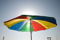 Sunshade 15. Colored sunshade on the coastline Stock Photos