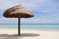 Sunshade. A shade at a tropical white sand beach Royalty Free Stock Photos