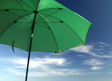 In the Sunshade. Huge Green Umbrella royalty free stock images
