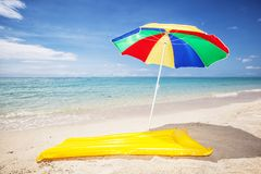 Sunshade and air mattress at a beach royalty free stock photos
