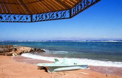 Sunshade on the beach, shade on sand. Coastline of The Red Sea i. N Dahab, Egypt Royalty Free Stock Photography
