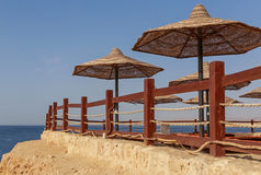 Sunshade beach umbrellas in resort Stock Image