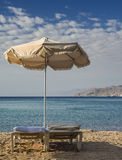 Sunshade and beds on sandy beach, Eilat Stock Photo