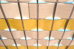 Sunshade in yellow and brown in close-up. stock image