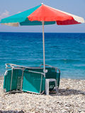 Sunshade with deck chair royalty free stock images