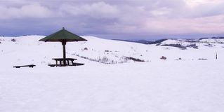Sunshade in the mountains snow stock photography