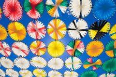Sunshade multicolored circles row in blue sky horizontal royalty free stock images